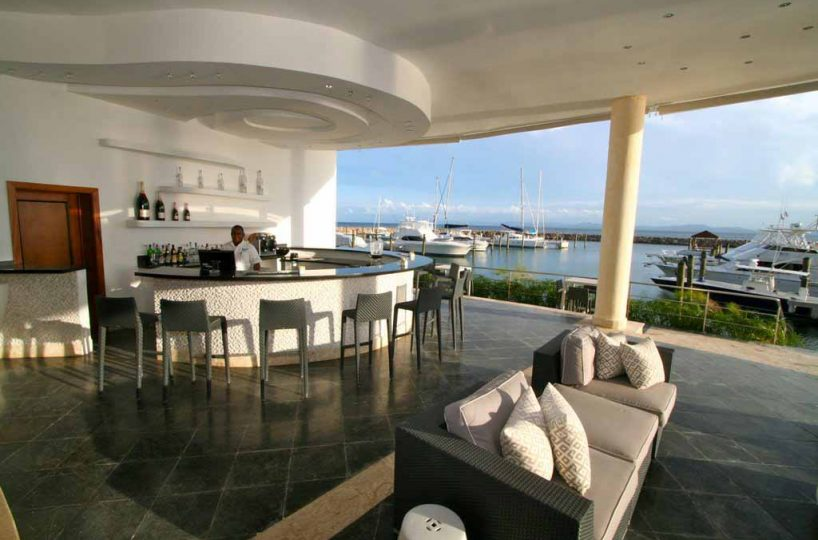 puerto-bahia-marina-and-residences-lobby-bar-view-to-the-marina